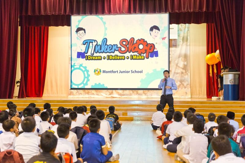 Mr Wong addressing the school on the opening of Tinker Shop.jpg